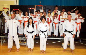 (Please Click to Enlarge) Wednesday 2nd July 2014. Examiners Sensei Martin Dobson (4th Dan) & Sensei Tony Cronk (3rd Dan) with Sensei Shahinaz Pelter, Patrick Pelter & some of Bromley & South East London JKA Karate Club students after the club's very succsseful grading with a 100% pass rate ! Many thanks to Sensei Martin & Sensei Tony. Congratulations to Everyone!