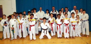 (Please Click to Enlarge) Wednesday 3rd December 2014. Examiners Sensei Martin Dobson (4th Dan) & Sensei Tony Cronk (3rd Dan) with Sensei Shahinaz Pelter, Patrick Pelter & some of Bromley & South East London JKA Karate Club students after the club's very succssessful grading with a 100% pass rate ! Many thanks to Sensei Martin & Sensei Tony. Well Done & Congratulations to Everyone! & Keep Training!