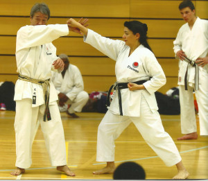 (Click to Enlarge) Sensei Shahinaz Pelter demonstrating with Sensei Omura 7th Dan some kata applications during the JKA England International Course.