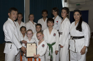 (Click to Enlarge) Sensei Ohta with Sensei Shahinaz Pelter, Patrick Pelter, William, Vicky, Joshua, Edward, Jaydn, James, Hewei, Jessica & Madison at Bromley & South East London JKA Karate Club, on 1st July 2015.