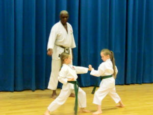(Click to Enlarge) Sensei Roy Tomlin (MBE) ( 7th Dan), with Jessica & Madison demonstrating a brilliant kumite exercise.