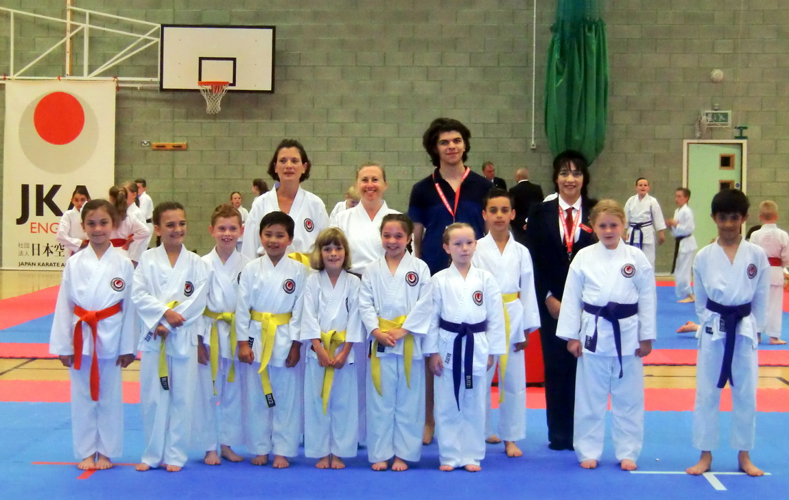 (Click to Enlarge) Sensei Shahinaz Pelter with Junior Instructor Patrick Pelter & Bromley & South East London JKA Karate Club squad: Vicky, Nicola, Vanessa, Lily Conner,Max, Charlotte, Aroa, Jessica, Kasim, Abi & Talvin.