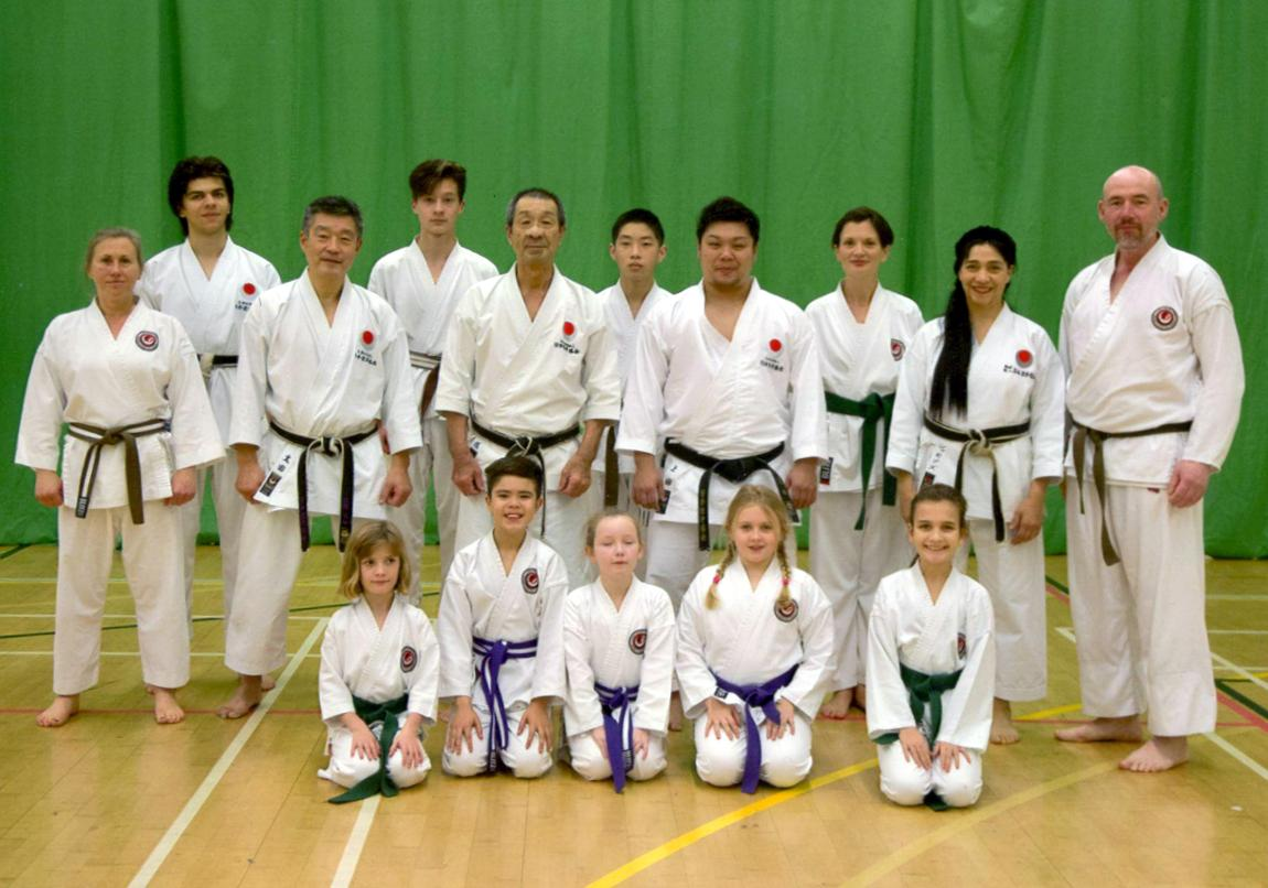 (Click to Enlarge) Sensei Shahinaz Pelter, Sensei Patrick Pelter, Mark, Nicola, Xin, William, Vicky, Charlotte, James, Jessica, Abi & Lily with three Great Japanese Instructors: Sensei Osaka (8th Dan), Sensei Ohta (7th Dan) & Sensei Ueda World Champion (4th Dan). JKAE International Course SDecember 2017.
